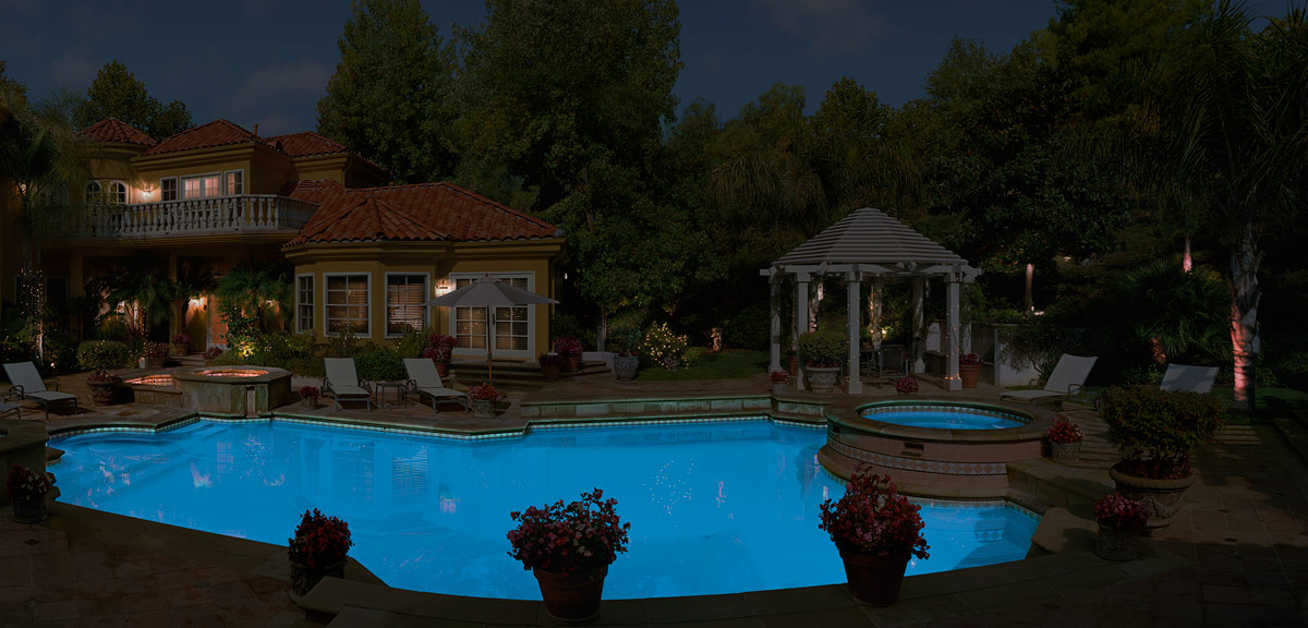Backyard Pool At Night : Stock Photo  Night view of a residential mansion backyard with a pool